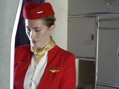 Stewardess fucks a passenger on a plane